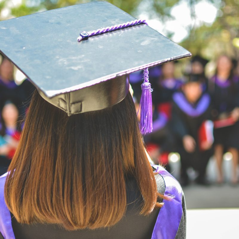 A young accountant graduate is graduating from college.